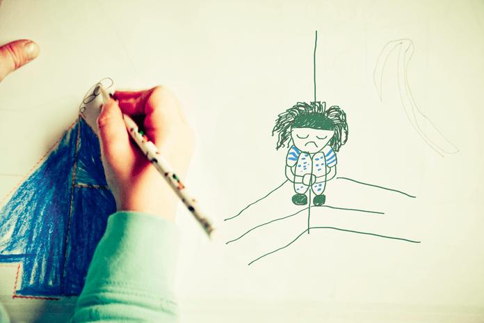 Dibujo de un niño que sufre acoso escolar o bullyng